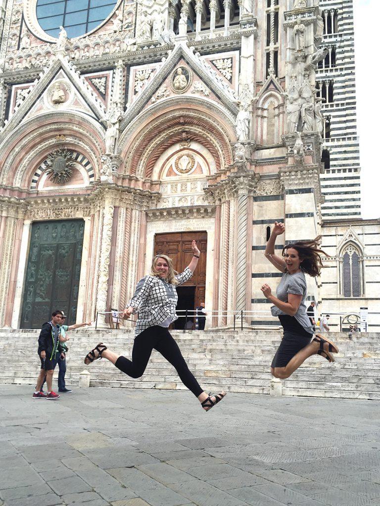Julie and Sara jumping.