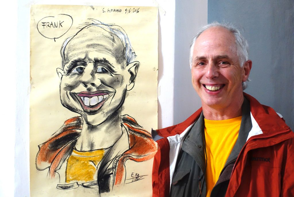 Frank poses with his caricature.
